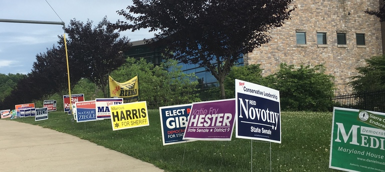 2018 campaign signs at the Miller Branch library